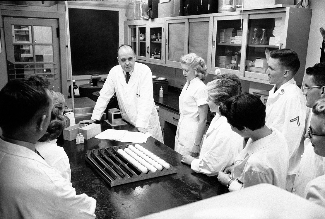 Maurice Hilleman in lab with team -Walter Reed